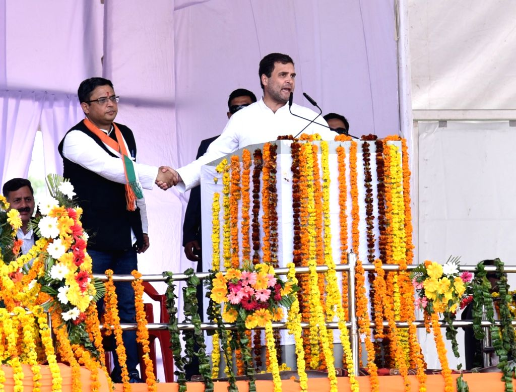 Congress President Rahul Gandhi with Manish Khanduri, the son of former Uttarakhand Chief Minister B.C. Khanduri, who joined the Congress at an election rally in Dehradun, on March 16, 2019. - B. and Rahul Gandhi