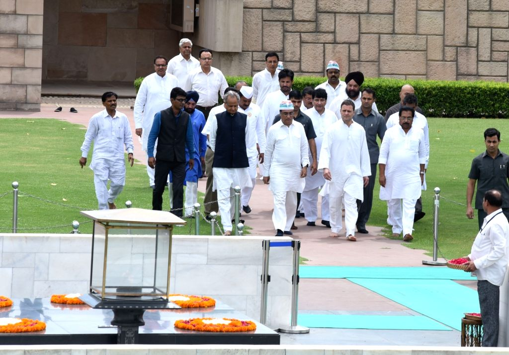 Congress President Rahul Gandhi with party leaders Ashok Gehlot, Ajay Maken and other leaders of the party, arrives at Rajghat during the Congress' day-long hunger-strike organised to ... - Rahul Gandhi
