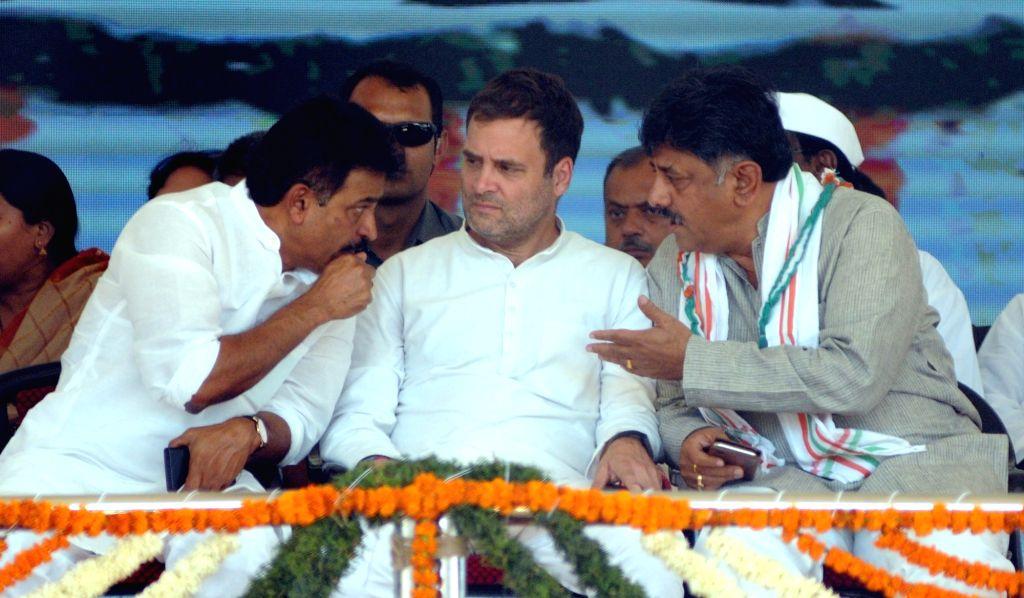 Congress President Rahul Gandhi with the party's General Secretary K. C. Venugopal and Karnataka Cabinet Minister D. K. Shivakumar during a  public rally in Karnataka's Kolar, on April 13, ... - D. K. Shivakumar and Rahul Gandhi