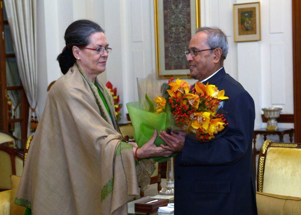 Congress president Sonia Gandhi greets President Pranab Mukherjee  on his birthday at Rashtrapati Bhawan in New Delhi, on Dec 11, 2015. - Pranab Mukherjee