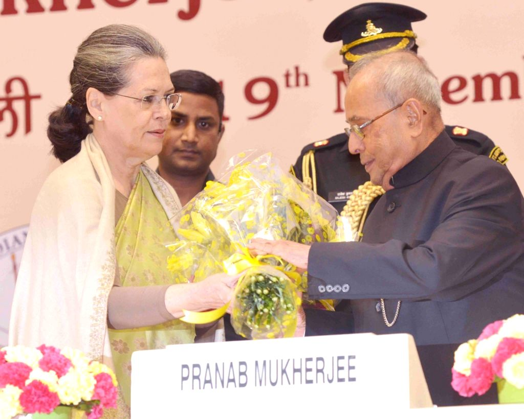 Congress president Sonia Gandhi greets the President Pranab Mukherjee at the Indira Gandhi Centenary Lecture being organised on the occasion of the birth anniversary of former Prime ... - Indira Gandhi, Sonia Gandhi and Pranab Mukherjee
