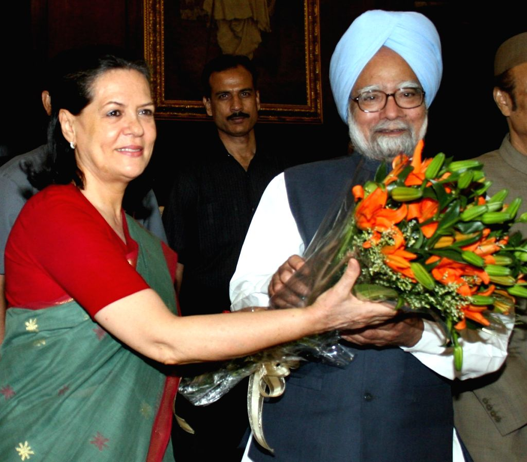 Congress President Sonia Gandhi presents a Bouquet to Prime Minister Manmohan Singh after he was elected the Leader of the congress Congress Parliamentry Party at Parliament House on Tuesday.
