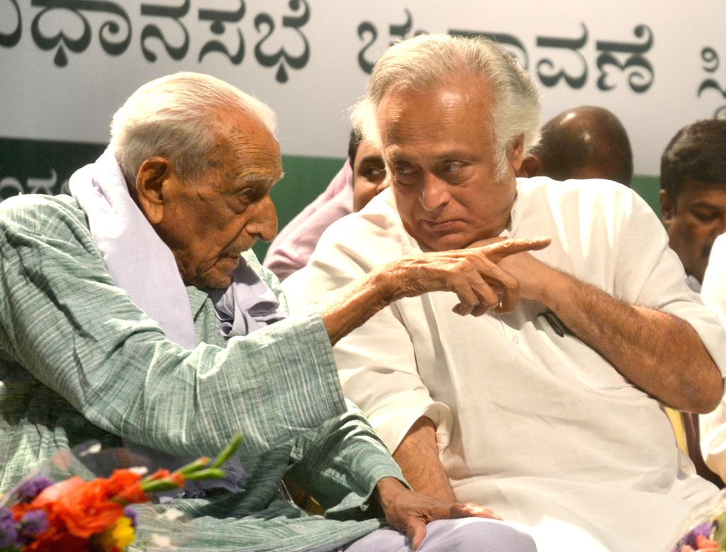 """Congress Rajya Sabha MP Jairam Ramesh in a conversation with freedom fighter H.S. Doreswamy during """"Samanjasa"""" - a programme organised to discuss simultaneous elections to the ..."""