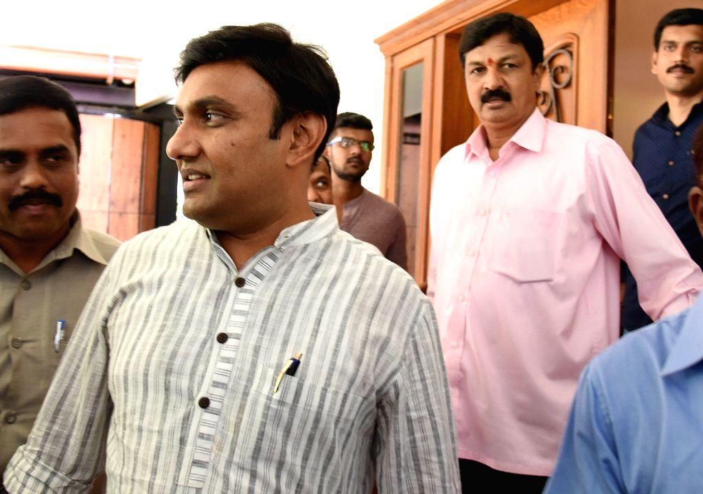 Congress' rebel legislator Ramesh Jarkiholi and K Sudhakar leave after meeting BJP leader SM Krishna, at his residence, in Bengaluru on May 26, 2019.