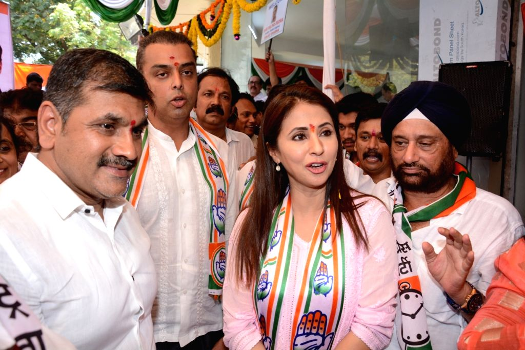 Congress's Lok Sabha candidate from Mumbai North constituency, Urmila Matondkar and party leader Milind Deora with NCP leader Sachin Ahir during inauguration of a party office in Mumbai on ...