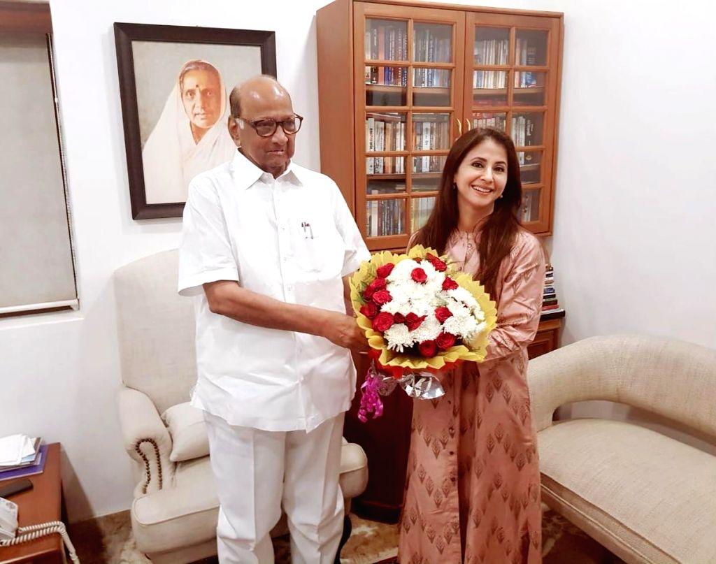 Congress's Lok Sabha candidate from Mumbai North constituency, Urmila Matondkar meets NCP chief Sharad Pawar in Mumbai, on April 11, 2019.