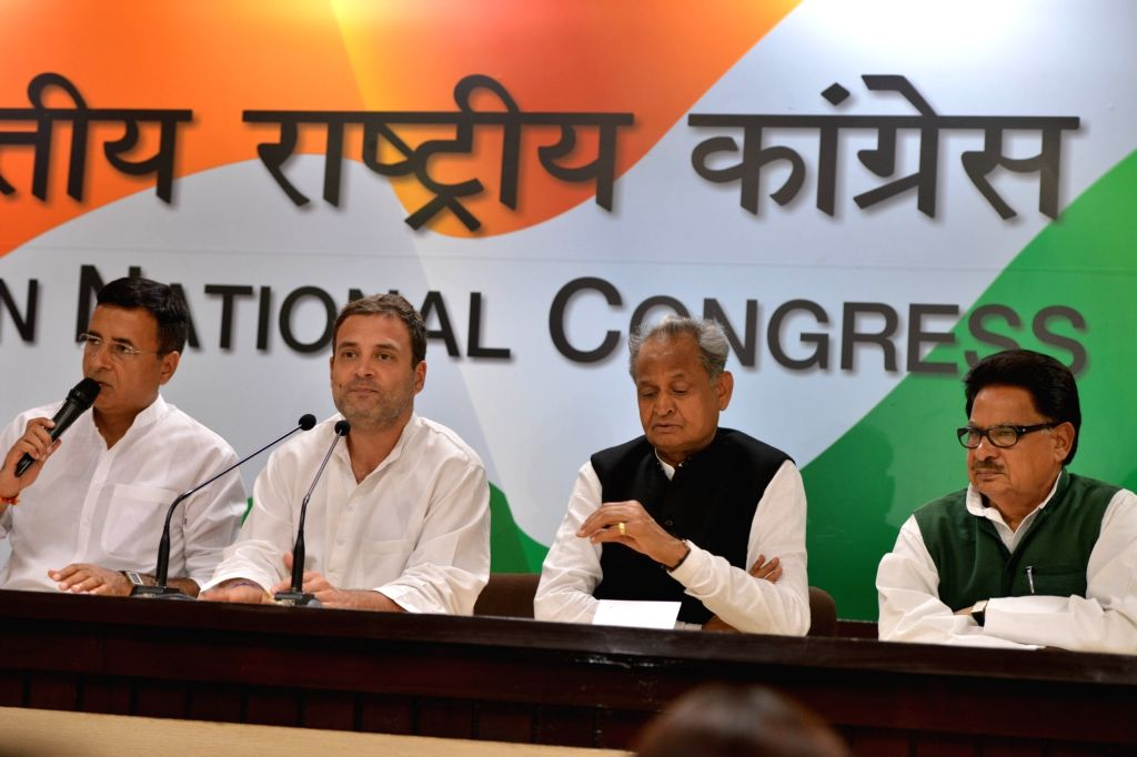 Congress spokesperson Randeep Surjewala and party president Rahul Gandhi address a press conference along with party leaders Ashok Gehlot and P. L .Punia, in New Delhi on Sept 13, 2018. - Rahul Gandhi