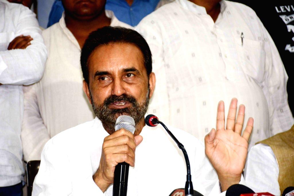 Congress spokesperson Shakti Singh Gohil addresses a press conference, in Patna on April 10, 2019. - Singh Gohil