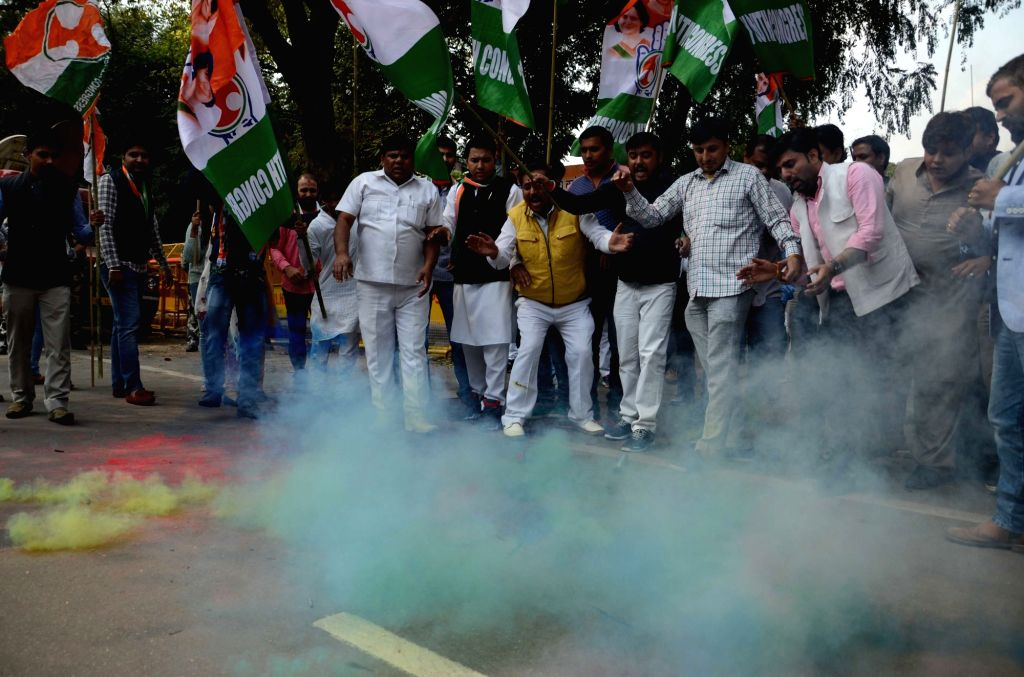 Congress supporters celebrate party's performance in the assembly elections; in New Delhi on March 11, 2017.