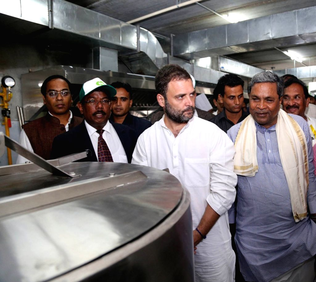 "Congress Vice President Rahul Gandhi and Karnataka Chief Minister Siddaramaiah during the inauguration of ""Indira Canteens"" in Bengaluru on Aug 16, 2017. - Siddaramaiah and Rahul Gandhi"