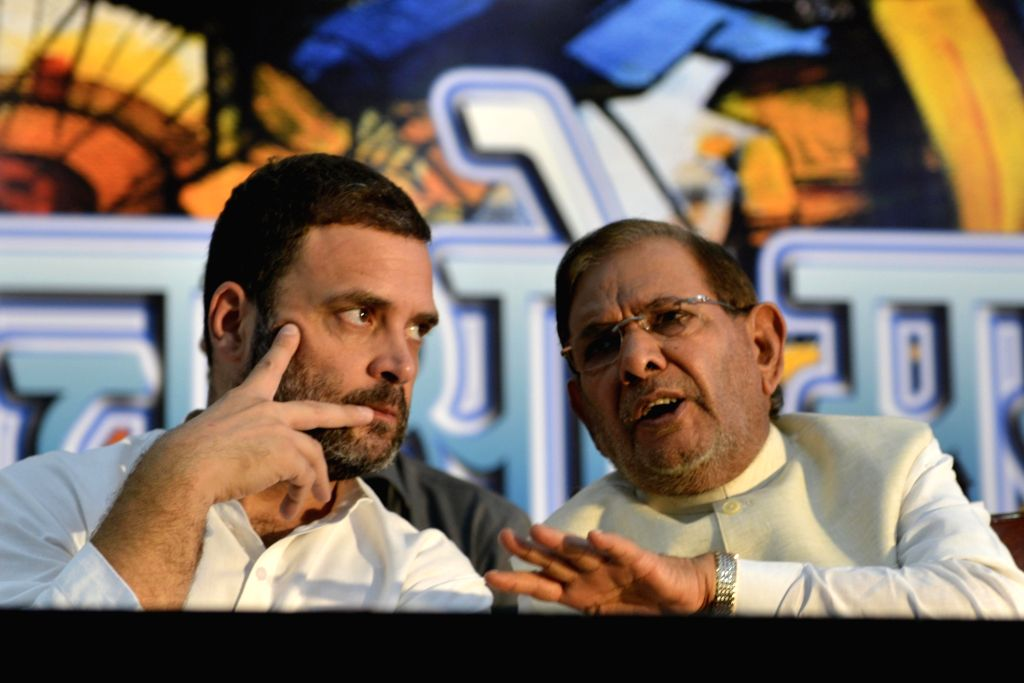 Congress Vice President Rahul Gandhi and former JD(U) chief Sharad Yadav during 'Sajha Virasat Bachao' (Save Composite Culture) conference in New Delhi on Aug 17, 2017. - Rahul Gandhi and Sharad Yadav