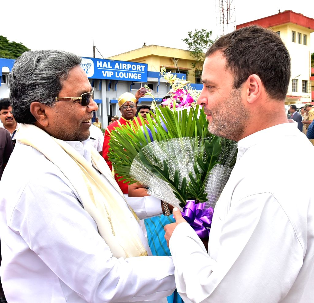 Congress Vice President Rahul Gandhi being welcomed by Karnataka Chief Minister Siddaramaiahon his arrival at HAL Airport in Bengaluru on June 12, 2017. - Siddaramaiaho and Rahul Gandhi