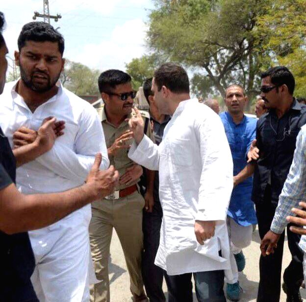 Congress vice president Rahul Gandhi being taken away by police when he tried to defy ban orders enforced in Madhya Pradesh's Mandsaur district where five protesting farmers were killed, in ... - Rahul Gandhi