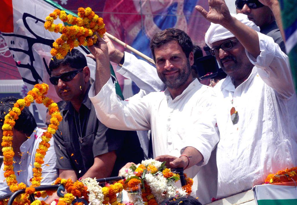 Congress vice president Rahul Gandhi campaigning with party candidate Ajay Rai in Varanasi on May 10, 2014. (Photo: IANS) - Rahul Gandhi and Ajay Rai