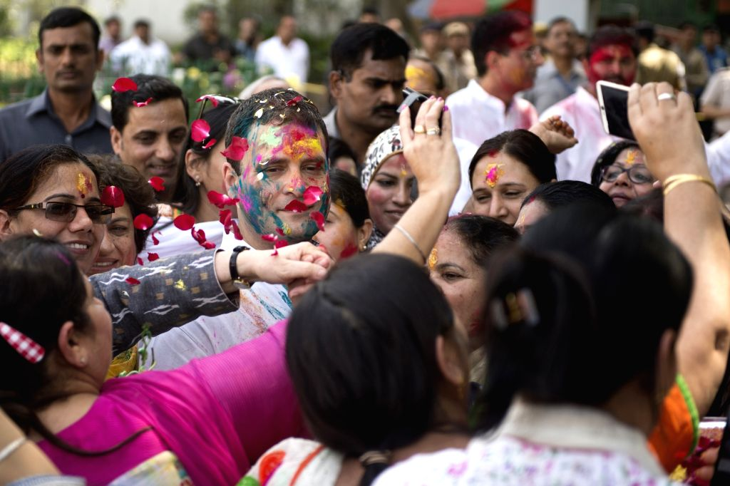 Congress vice president Rahul Gandhi celebrates Holi at Congress headquarters in New Delhi on March 24, 2016. - Rahul Gandhi
