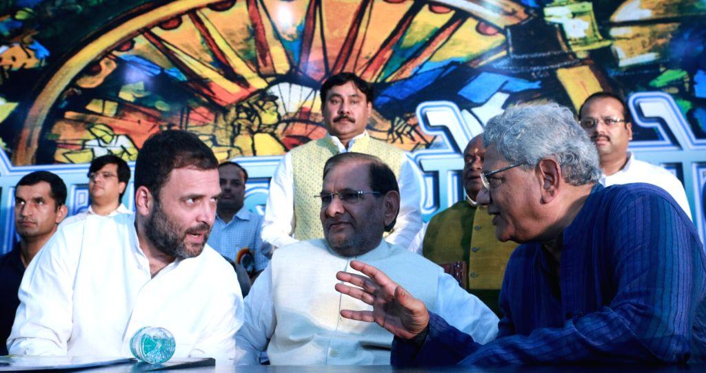 Congress Vice President Rahul Gandhi, CPI(M) general secretary Sitaram Yehchury and former JD(U) chief Sharad Yadav during the Sanjhi Virasat Bachao programme in New Delhi on Aug 17, 2017. - Rahul Gandhi and Sharad Yadav