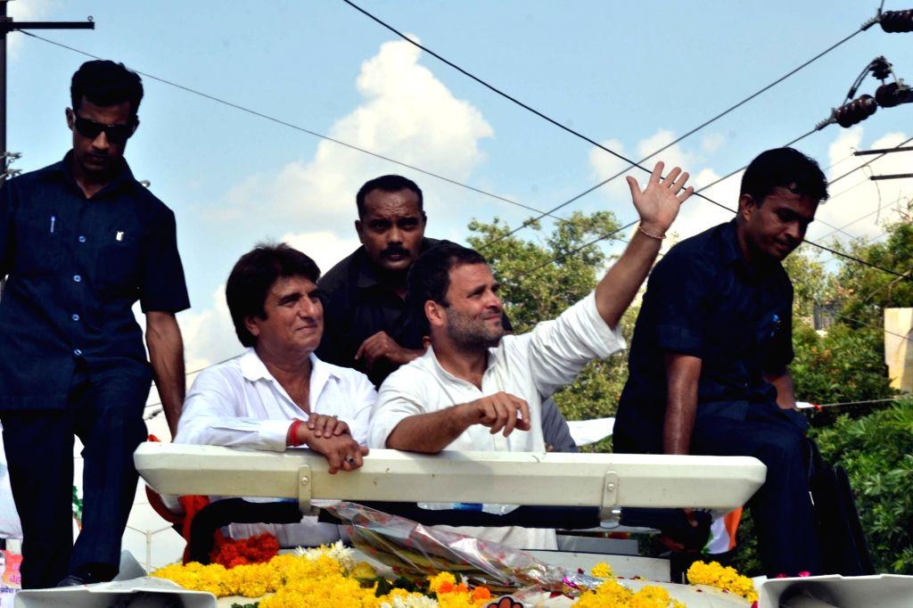Congress vice president Rahul Gandhi during a roadshow in Agra on Oct 1, 2016. Also seen Uttar Pradesh Congress chief Raj Babbar. - Rahul Gandhi