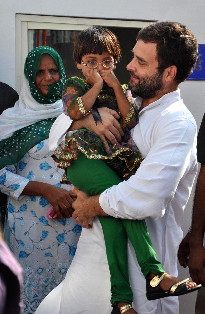 Congress Vice President Rahul Gandhi interacts with a child during inauguration of Indra Gandhi Eye Hospital at Sohna near Mewat, Gurgaon on Aug 8, 2014. - Rahul Gandhi