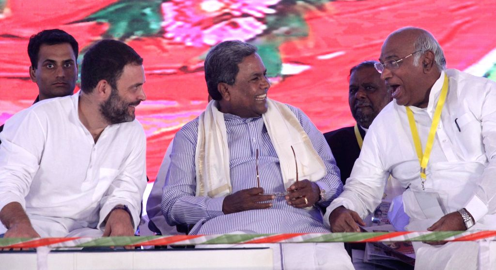 "Congress Vice President Rahul Gandhi, party leader Mallikarjuna Kharge and Karnataka Chief Minister Siddaramaiah during the inauguration of ""Indira Canteens"" in Bengaluru on Aug ... - Siddaramaiah and Rahul Gandhi"