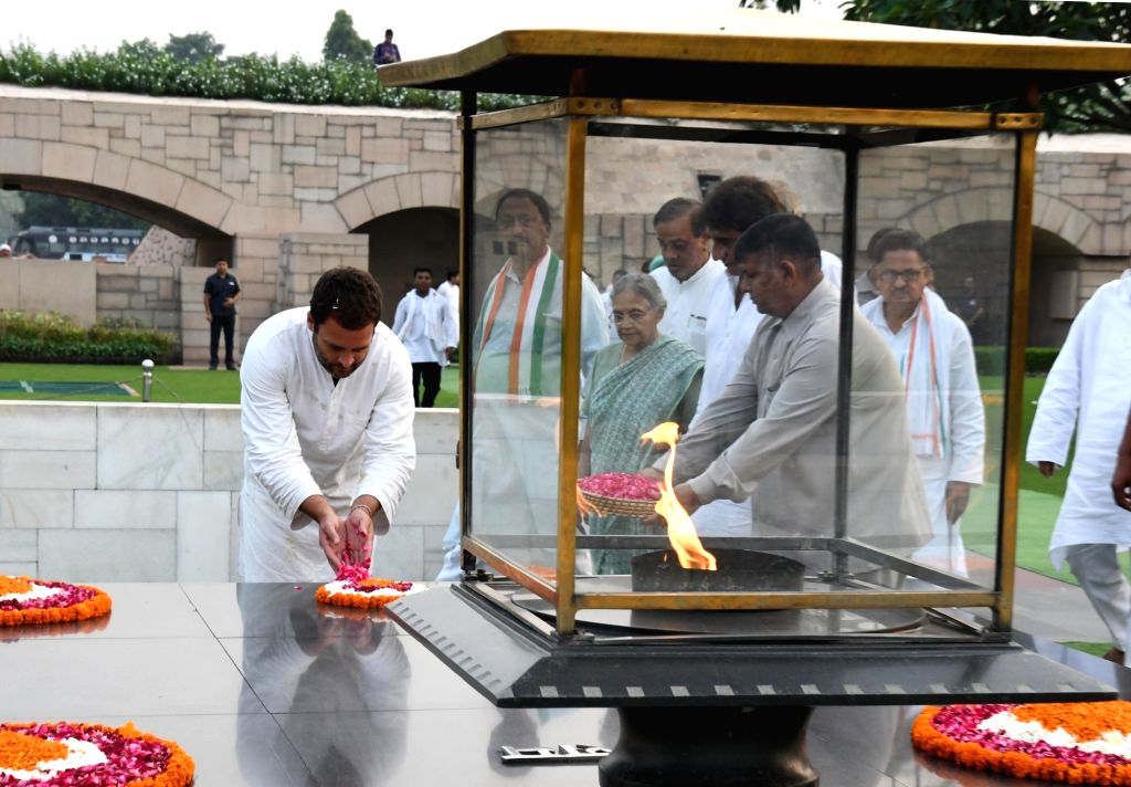 Congress vice president Rahul Gandhi pays tribute at Rajghat in New Delhi, on Oct 6, 2016. He returned to Delhi after winding up his 26-day 'Kisan Yatra' across Uttar Pradesh on Thursday ... - Rahul Gandhi