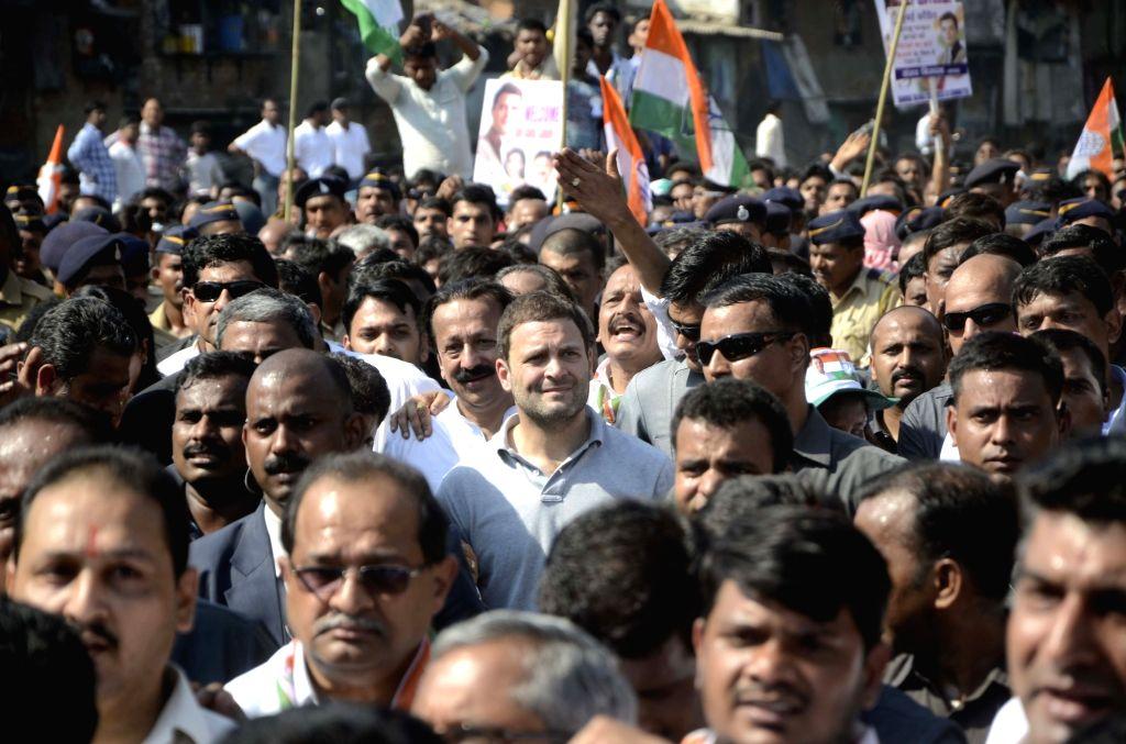 Congress vice president Rahul Gandhi walks during his padyatra to Dharavi slums in Mumbai, on Jan 16, 2016.