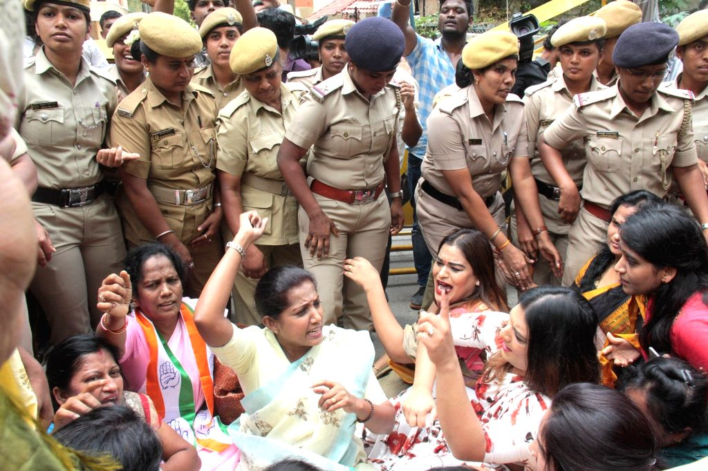 Congress women activists being taken away by police during their demonstration against Karnataka Minister K.S. Eshwarappa, in Bengaluru on Sep 27, 2019. - K.