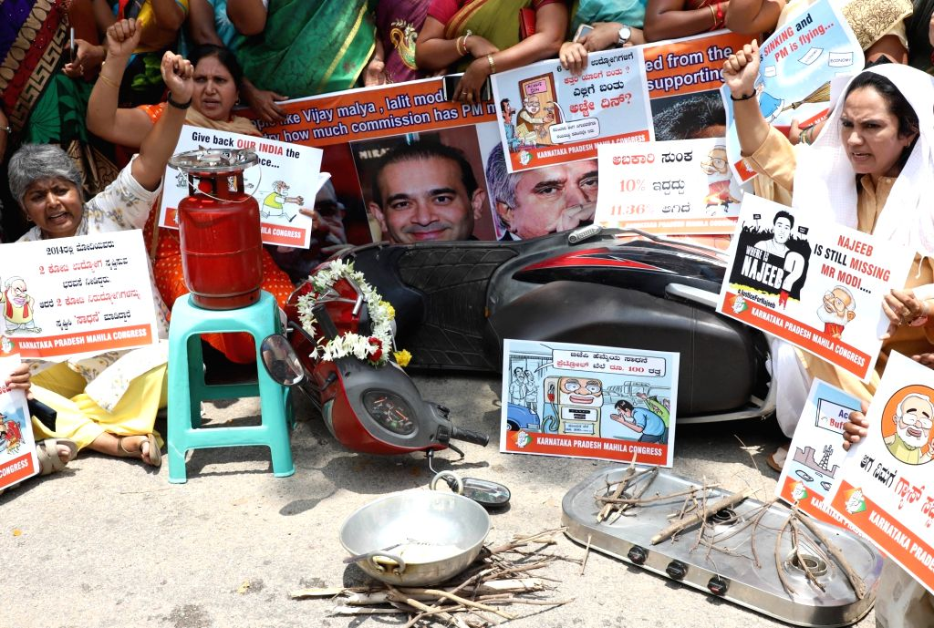 Congress' women activists stage a demonstration against Prime Minister Narendra Modi on the occasion of  the 4th anniversary of Narendra Modi-led BJP government, in Bengaluru on May 26, ... - Narendra Modi