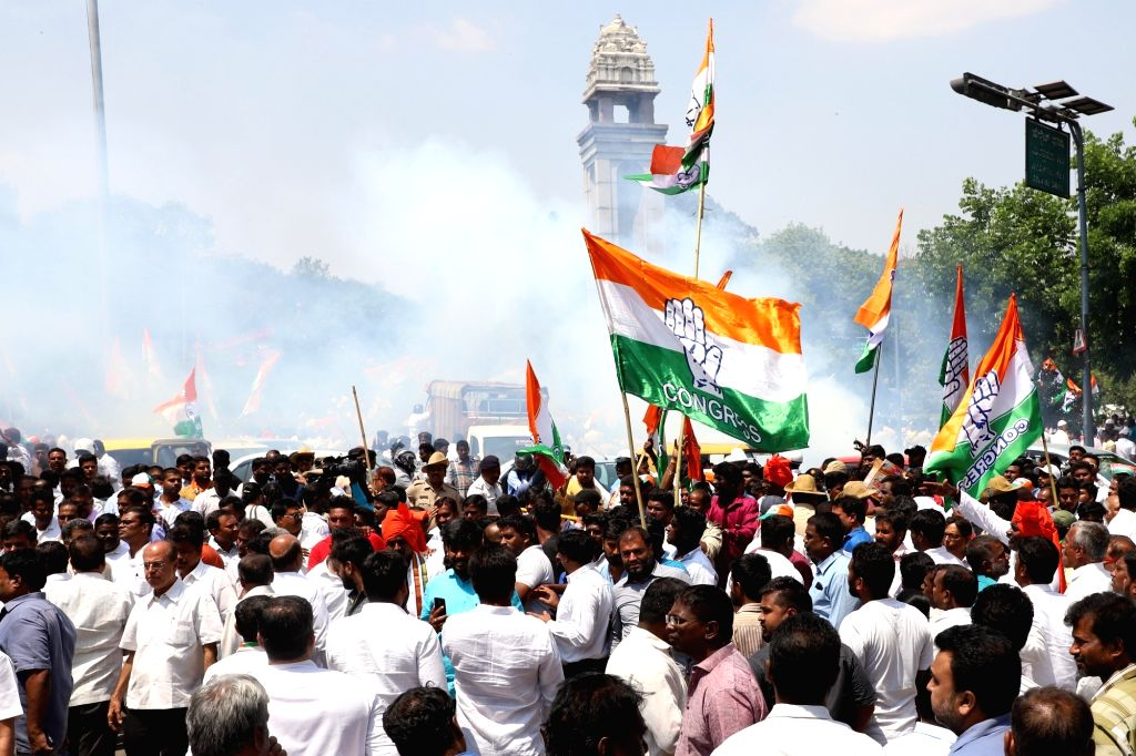 Congress workers accompany the party's Lok Sabha candidate from Bengaluru Central, Rizwan Harshad as he heads to file his nomination papers for 2019 Lok Sabha elections in Bengaluru, on ...