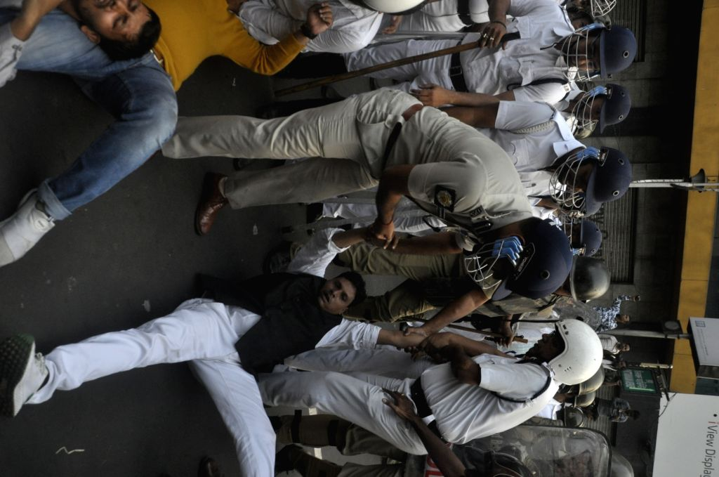 Congress workers being taken away by police during their protest rally against Kolkata Municipal Corporation (KMC) over their various demands, on Dec 19, 2019.