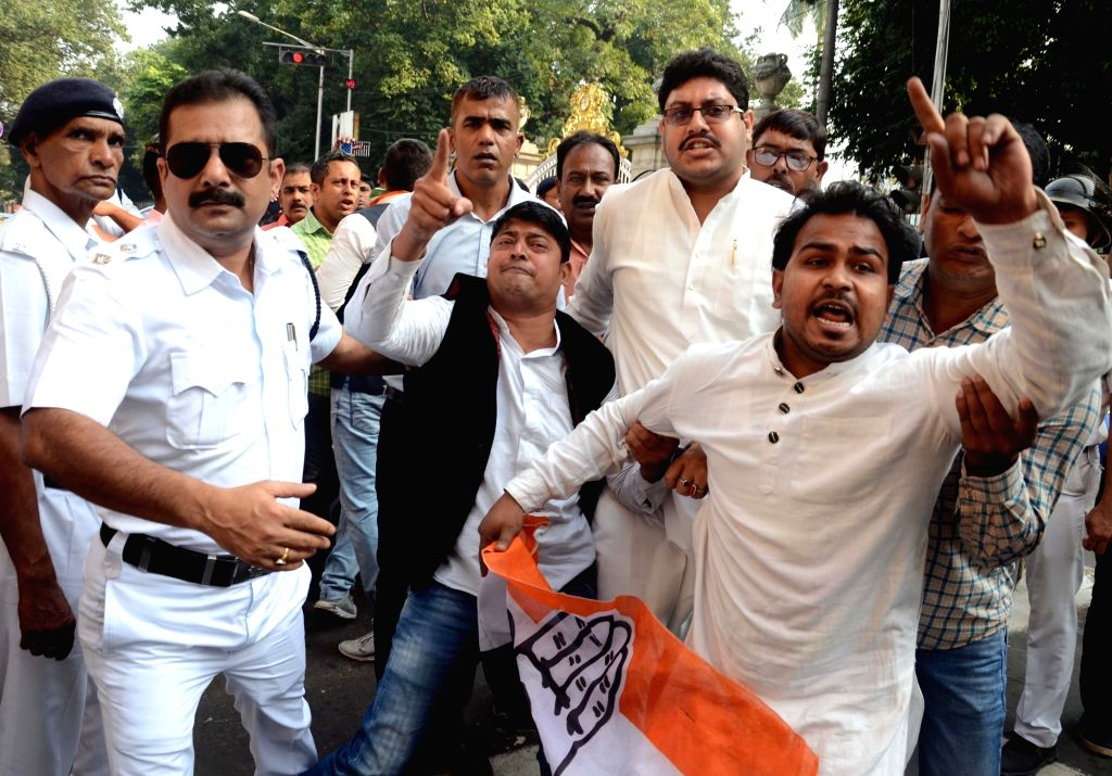 Congress workers being taken away by the police during the party's demonstration outside Raj Bhawan after a bust of former West Bengal Chief Minister Bidhan Chandra Roy was found vandalised ... - Bidhan Chandra Roy