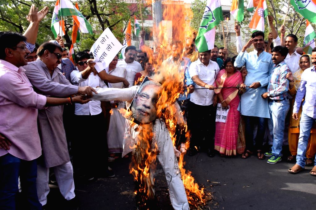 Congress workers burn an effigy of Prime Minister Narendra Modi during a protest against hike in fuel prices in Jaipur, on May 21, 2018. - Narendra Modi