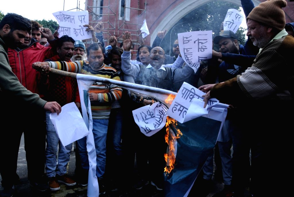 Congress workers burn Pakistan flag during a protest against suicide attack on a CRPF bus in Jammu and Kashmir's Pulwama district in which atleast 45 soldiers lost their lives; in Amritsar ...
