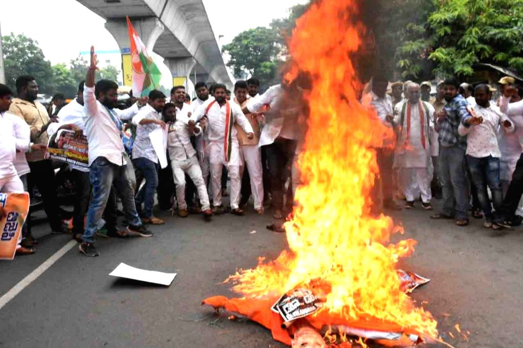 Congress workers burn the effigy of Uttar Pradesh Chief Minister Yogi Adityanath after Priyanka Gandhi was detained while she was going to meet the families of the victims of Sonebhadra ... - Yogi Adityanath and Priyanka Gandhi