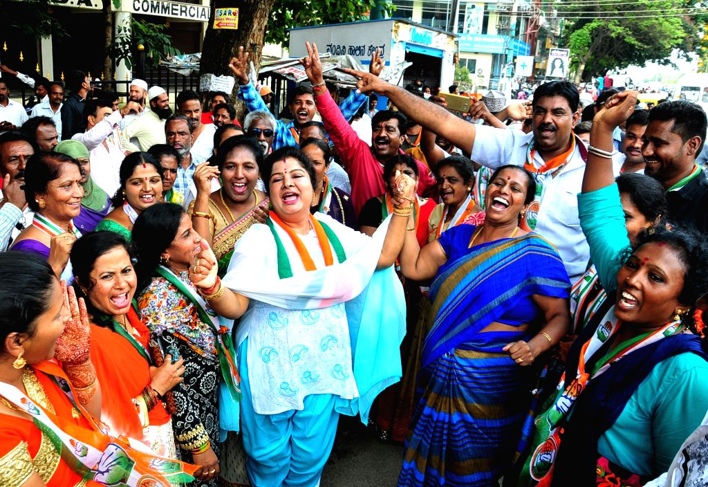 Congress workers celebrate after Congress candidate Muniratna won Rajarajeshwari Nagar assembly seats in the bypoll; in Bengaluru on May 31, 2018.