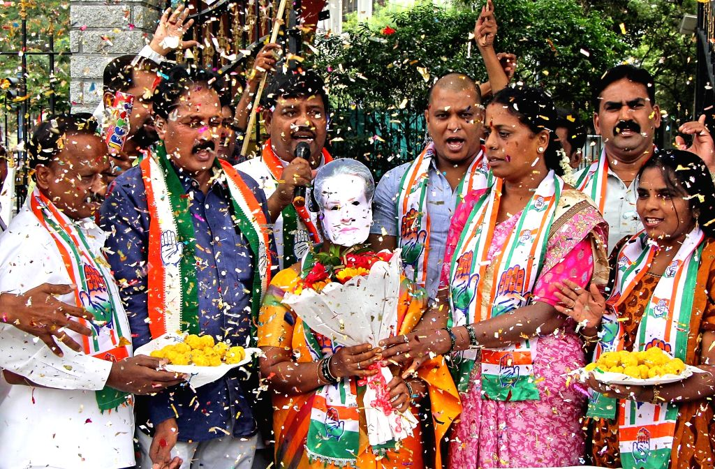 Congress workers celebrate after Sonia Gandhi was elected as the leader of the Congress Parliamentary Party, in Bengaluru on June 3, 2019. - Sonia Gandhi