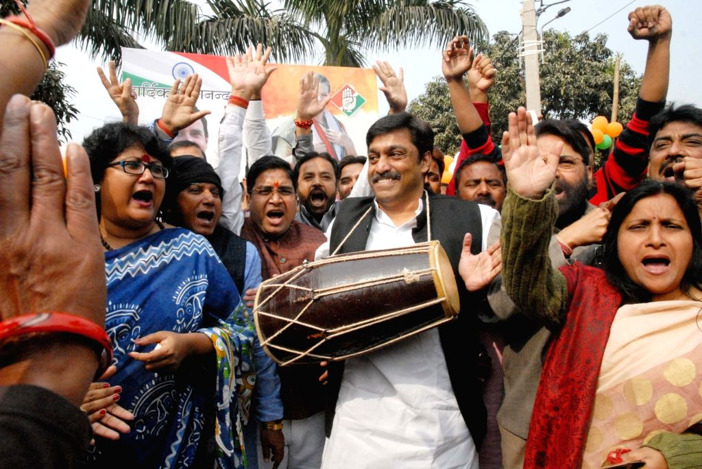 Congress workers celebrate as the party appeared to be on the road to victory in BJP-ruled Chhattisgarh and possibly Rajasthan and was locked in a close fight in Madhya Pradesh, in Patna on ...