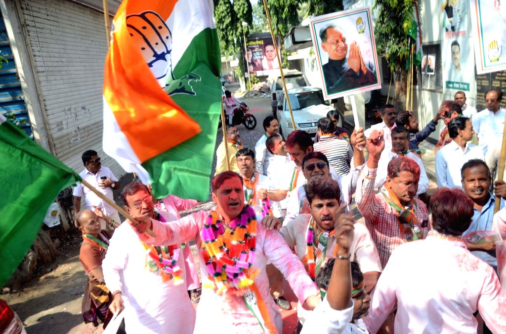 Congress workers celebrate at the party office as the party appeared to be on the road to victory in BJP-ruled Chhattisgarh and possibly Rajasthan and was locked in a close fight in Madhya ...