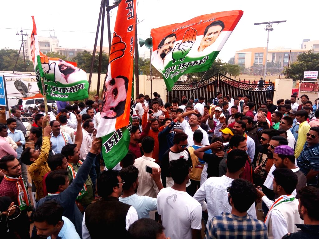Congress workers celebrate outside the party office as the party appeared to be on the road to victory in BJP-ruled Chhattisgarh and possibly Rajasthan and was locked in a close fight in ...