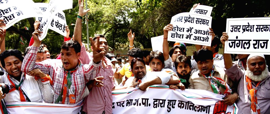 Congress workers demonstrate against attack on Congress leader Hasan Ahmad in Lucknow; in New Delhi on April 24, 2014. Ahmad was attacked during a press conference.