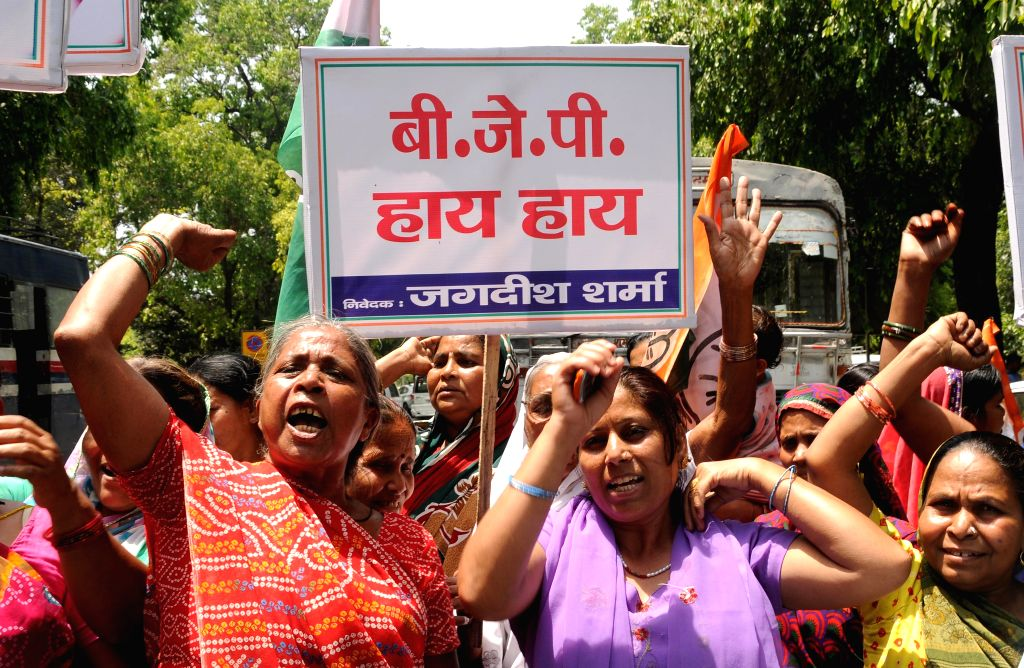 Congress workers demonstrate against BJP Prime Ministerial candidate and Gujarat Chief Minister Narendra Modi in front of BJP office in New Delhi on May 1, 2014.