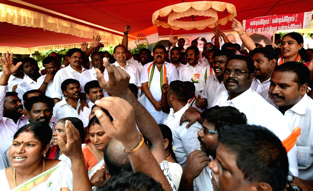 Congress workers demonstrate against rail tariff hike in Chennai on June 27, 2014.