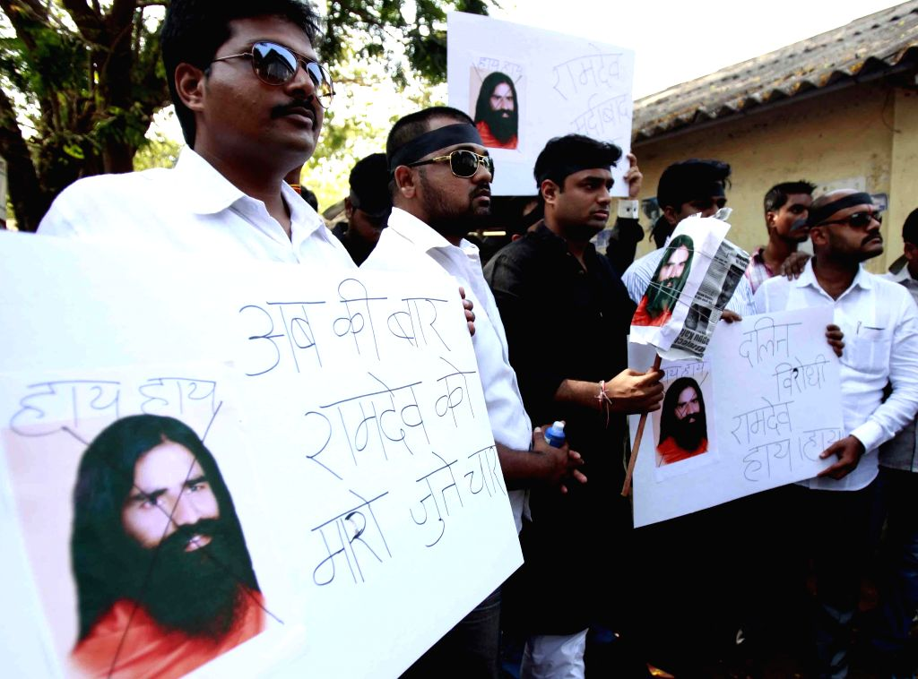 Congress workers demonstrate against Yoga guru Ramdev for his anti-dalit remark, in Mumbai on April 28, 2014.