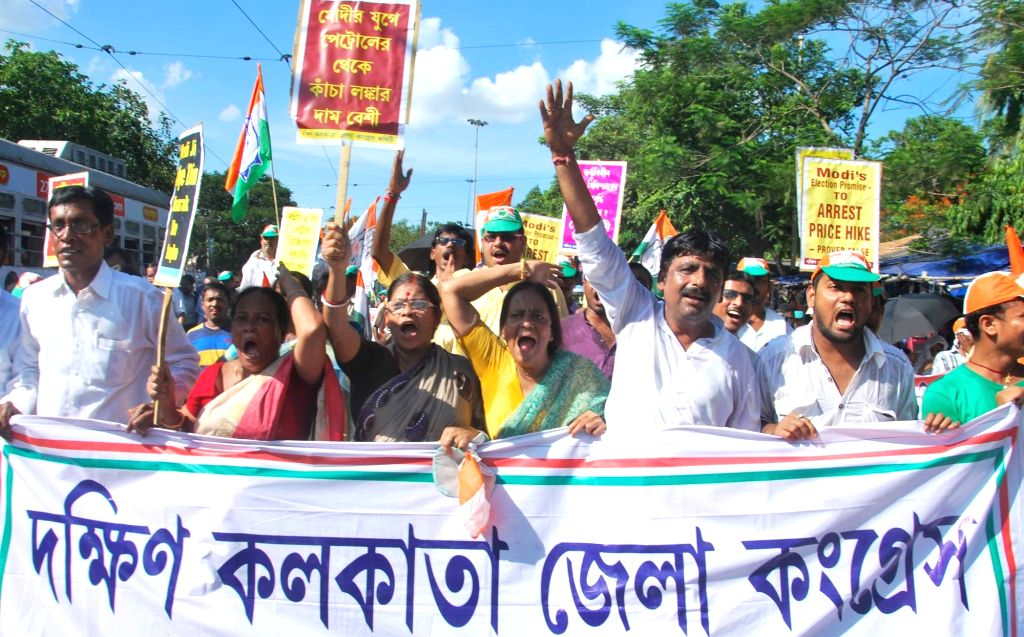 Congress workers during a protest rally against the price hike of commodities in Kolkata, on June 25, 2016.