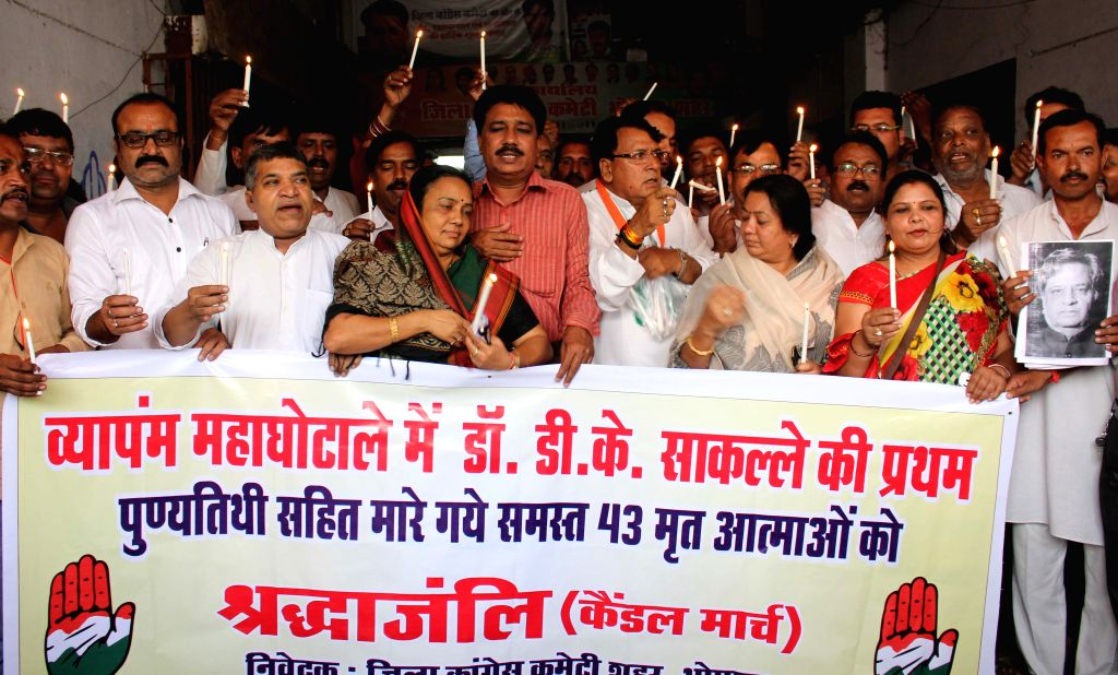Congress workers holding a candle light march to pay homage to the deceased linked to the PEB scam, in Bhopal on July 4, 2015.