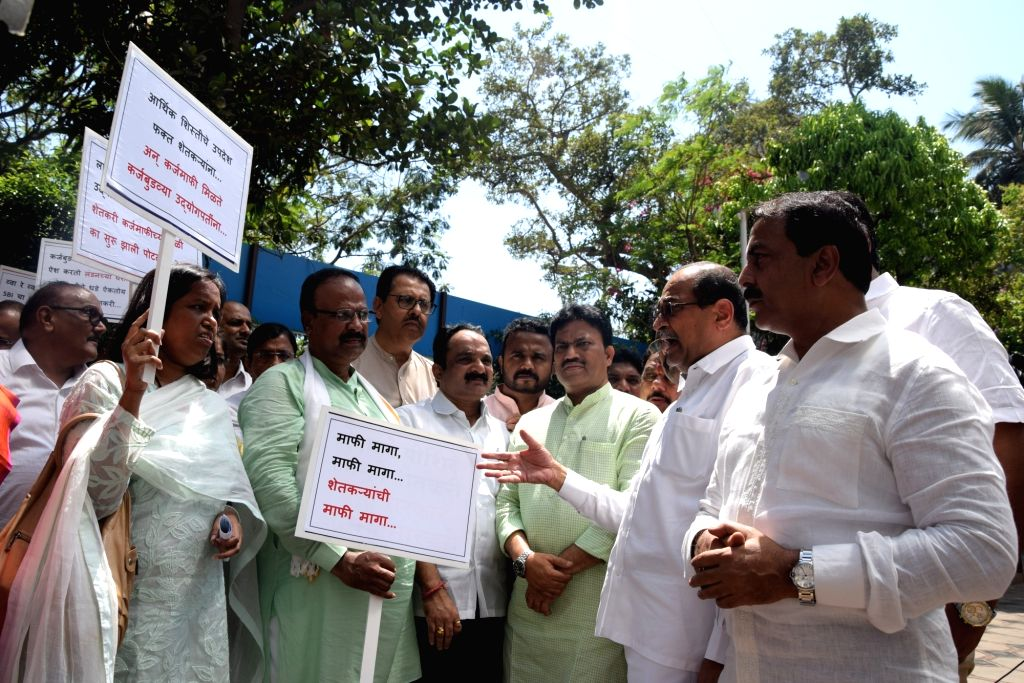 Congress workers including legislators stage a demonstration against SBI Chairperson Arundhati Bhattacharya's remarks on farm loans waiver outside the State Bank of India headquarters in ...