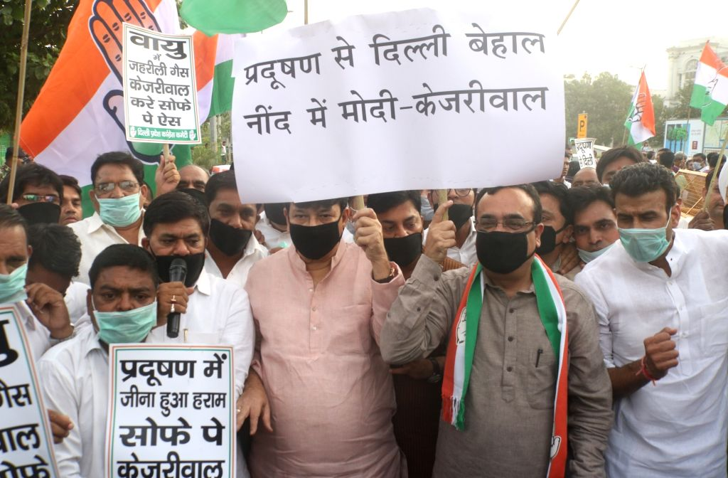Congress workers led by Delhi party chief Ajay Maken stage a protest march against Delhi Chief Minister Arvind Kejriwal  in New Delhi, on June 14, 2018. - Arvind Kejriwal