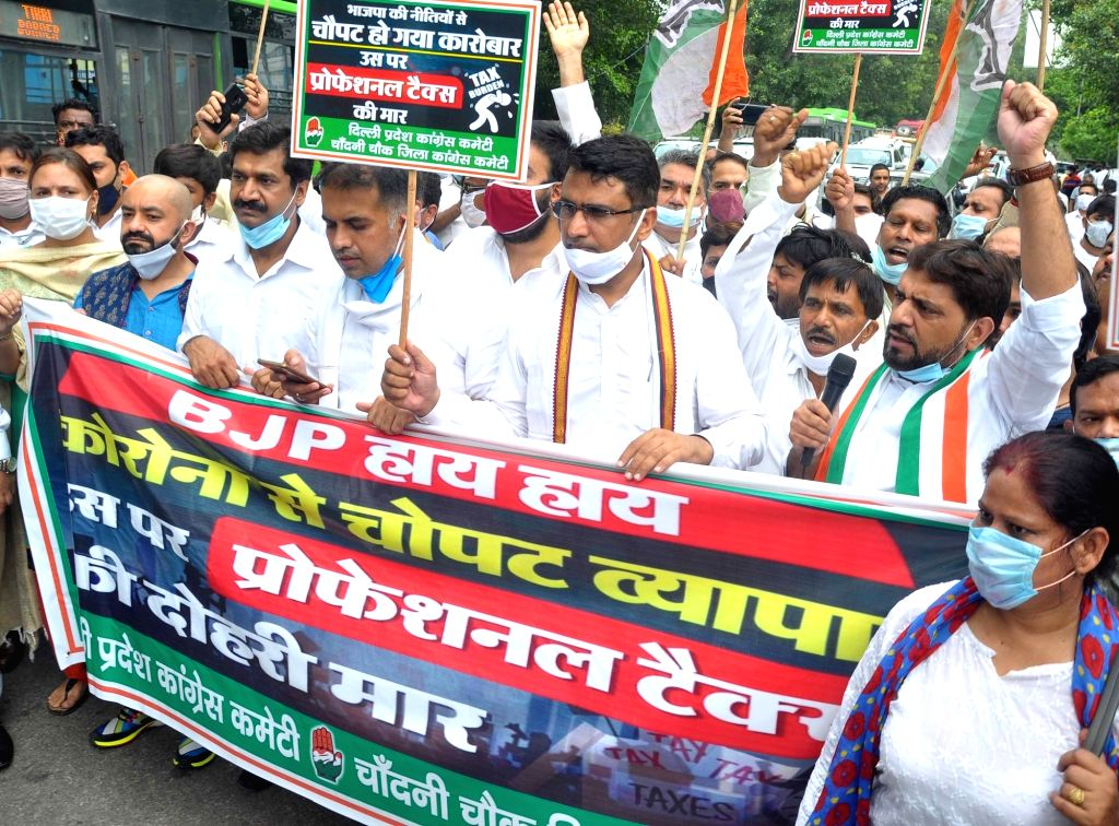 Congress workers led by Delhi party president Anil Kumar stage a demonstration against BJP-ruled South Delhi Municipal Corporation's decision to levy professional tax as well as its plan ... - Kumar