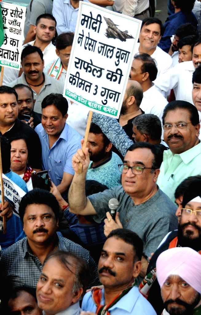 Congress workers led by party leader Ajay Maken stage a demonstration against Prime Minister Narendra Modi over alleged corruption in the Rafale deal; in New Delhi on Sept 8, 2018. - Narendra Modi