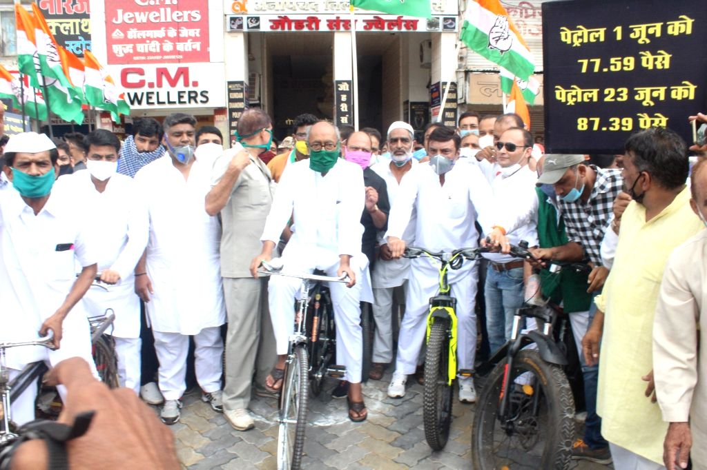 Congress workers led by senior party leader Digvijaya Singh, participate in a cycle rally to protest against hike in the price of petrol and diesel, in Bhopal on June 24, 2020. - Digvijaya Singh