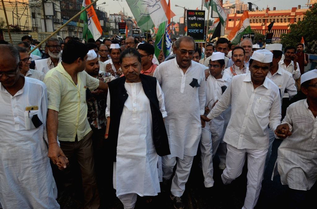 Congress workers led by West Bengal party president Somen Mitra, stage a demonstration against the killing of five people by militants in Kherbari of Assam's Tinsukia district; in Kolkata on ...